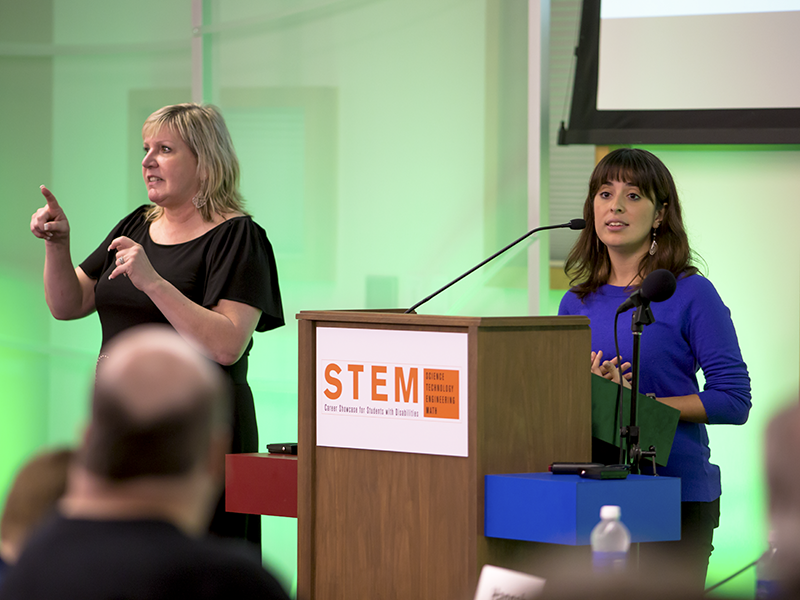 STEM Career Showcase organizer Liani Yirka and American Sign Language interpreter at the 2014 event