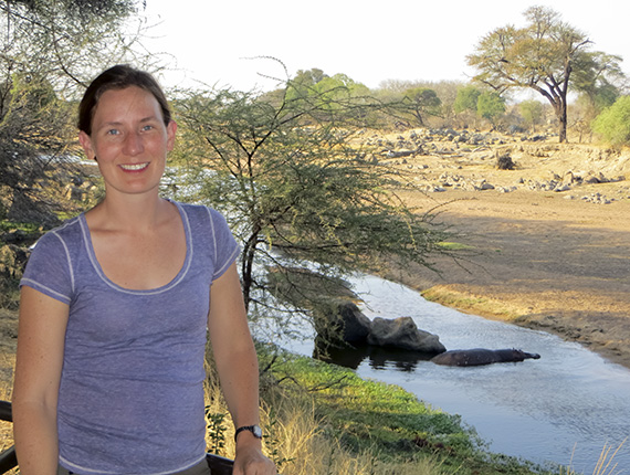 Dr. Corinne Kendall with hippo in background.