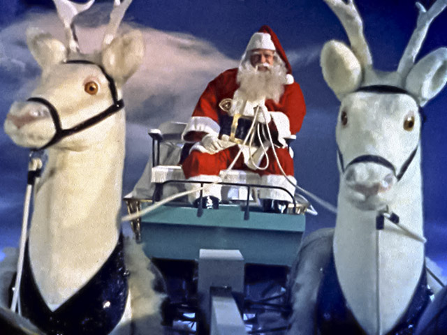 Santa Claus (1959) still image showing Santa, sleigh, and two white reindeer.