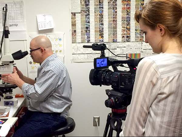 Teen Newsroom student filming Research Curator of Geology Christopher Tacker.