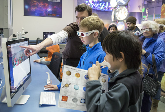 Patrick Treuthardt demonstrates how to use a 3D virtual landscape of Mars. Photo: Karen Swain/NCMNS.