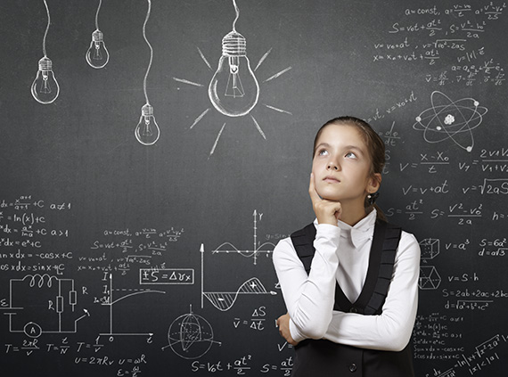 Girl in front of blackboard with formulas.