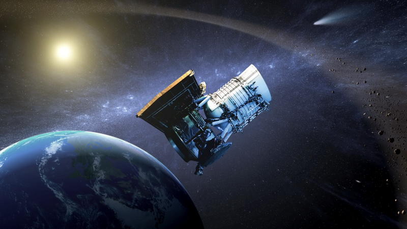 This artist's concept shows the Wide-field Infrared Survey Explorer, or WISE spacecraft, in its orbit around Earth. Image credit: NASA/JPL-Caltech.