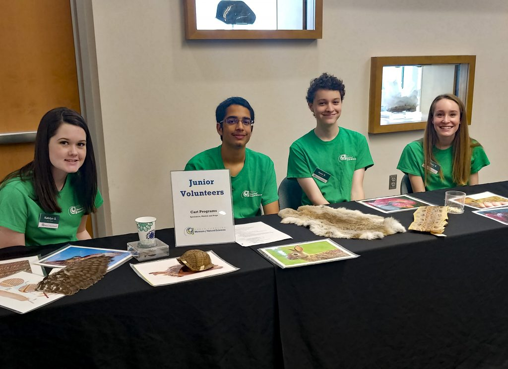 Junior Volunteers staff a table at the 2017 Teen Volunteer Fair.