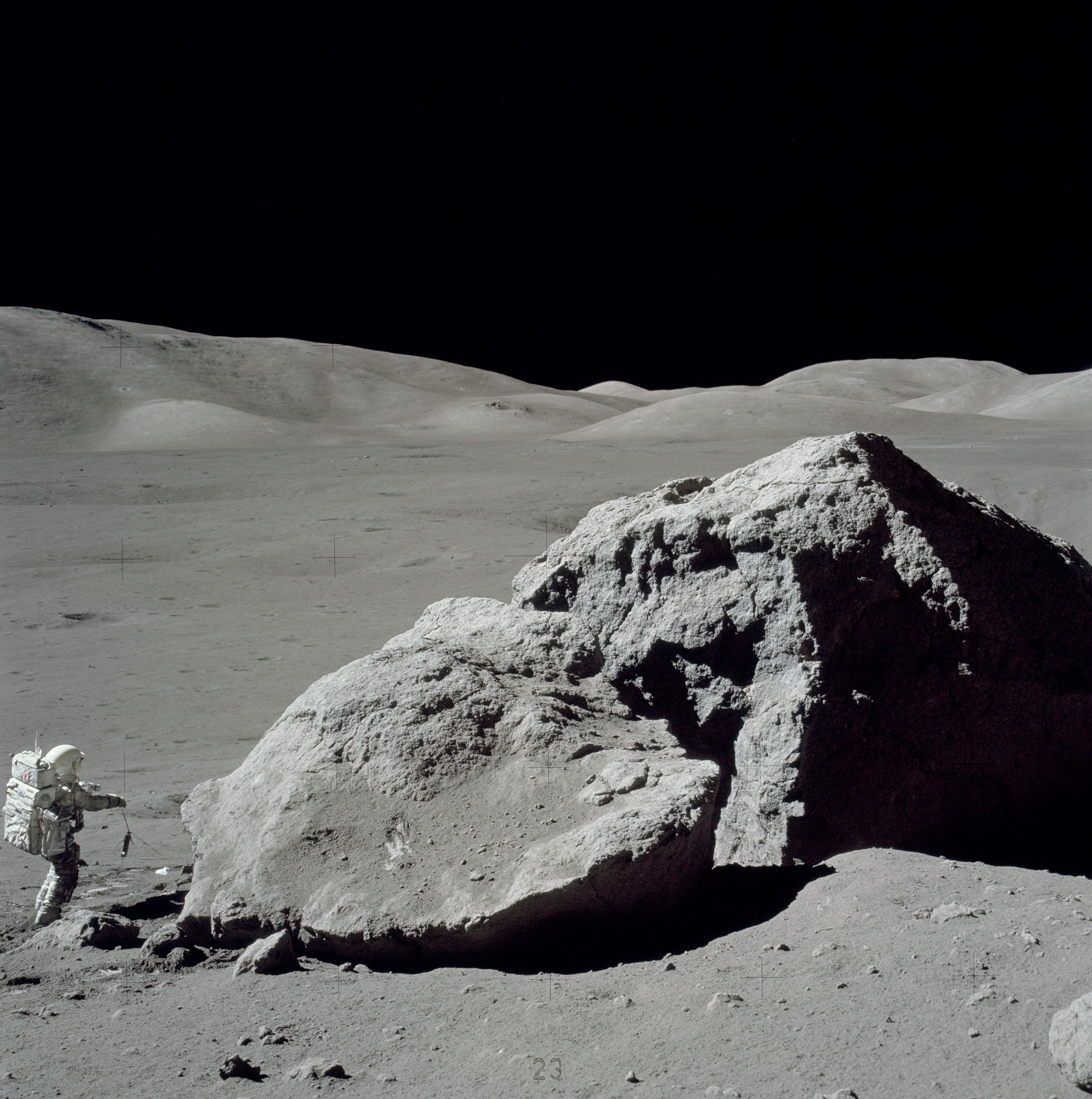 Apollo 17 astronaut Harrison Schmitt standing next to a boulder at Taurus-Littrow during the third EVA.
