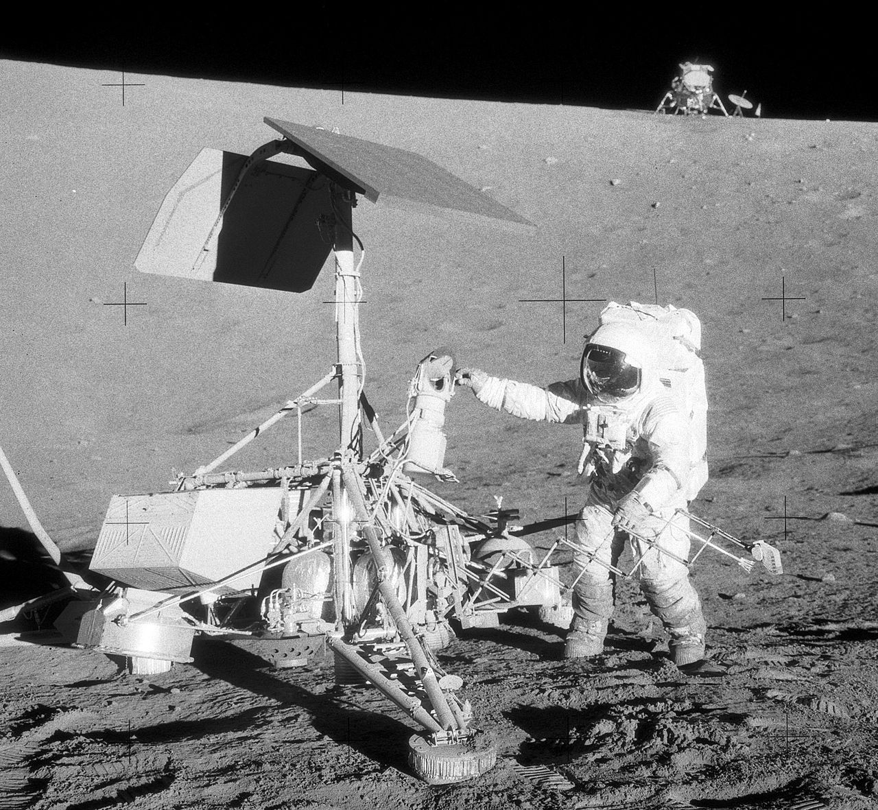 Astronaut Pete Conrad near Surveyor 3 during Apollo 12, 1969. Lunar module in the background.