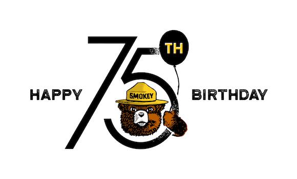 Happy Birthday text with Smokey Bear's head and arm holding a birthday balloon