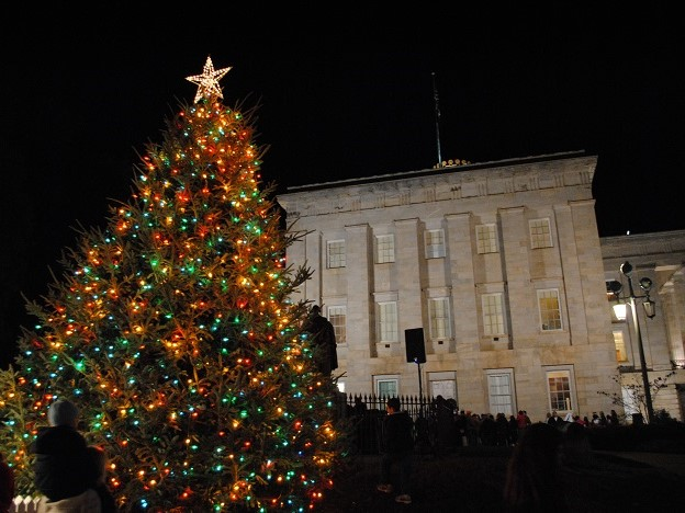A massive Christmas tree in front of the NC Capitol building.