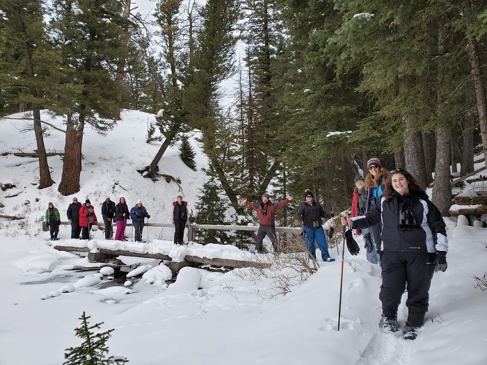 A group of educators adventure through the snow.