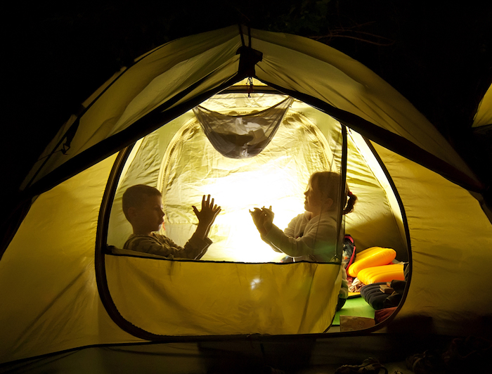Kids are camping in their backyard!