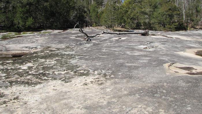 A flat granite ground.