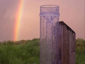 Rain gauge and rainbow.