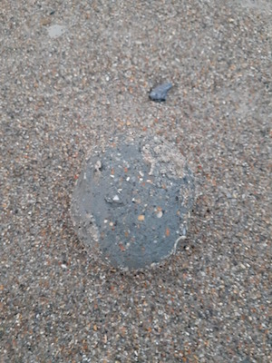 A squishy ball of sand appeared on the beach ground.