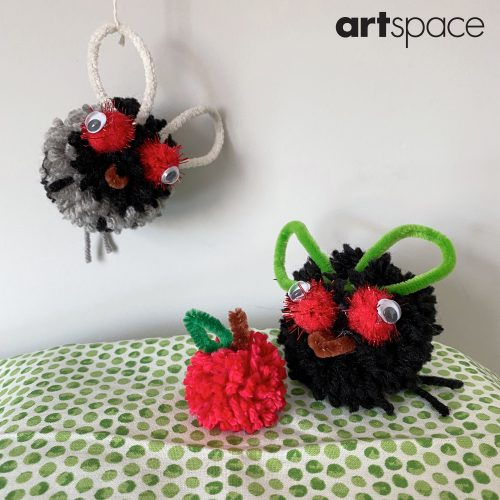 Little flies made from pom-poms