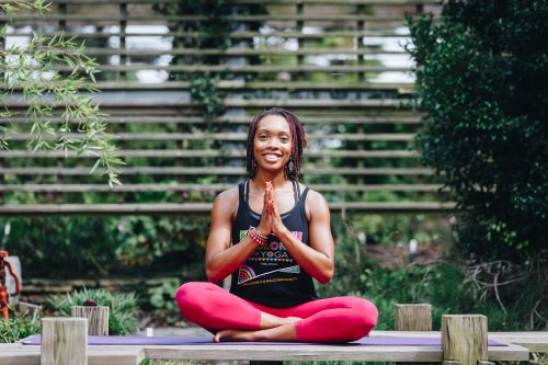 A woman in a lotus yoga pose. pose