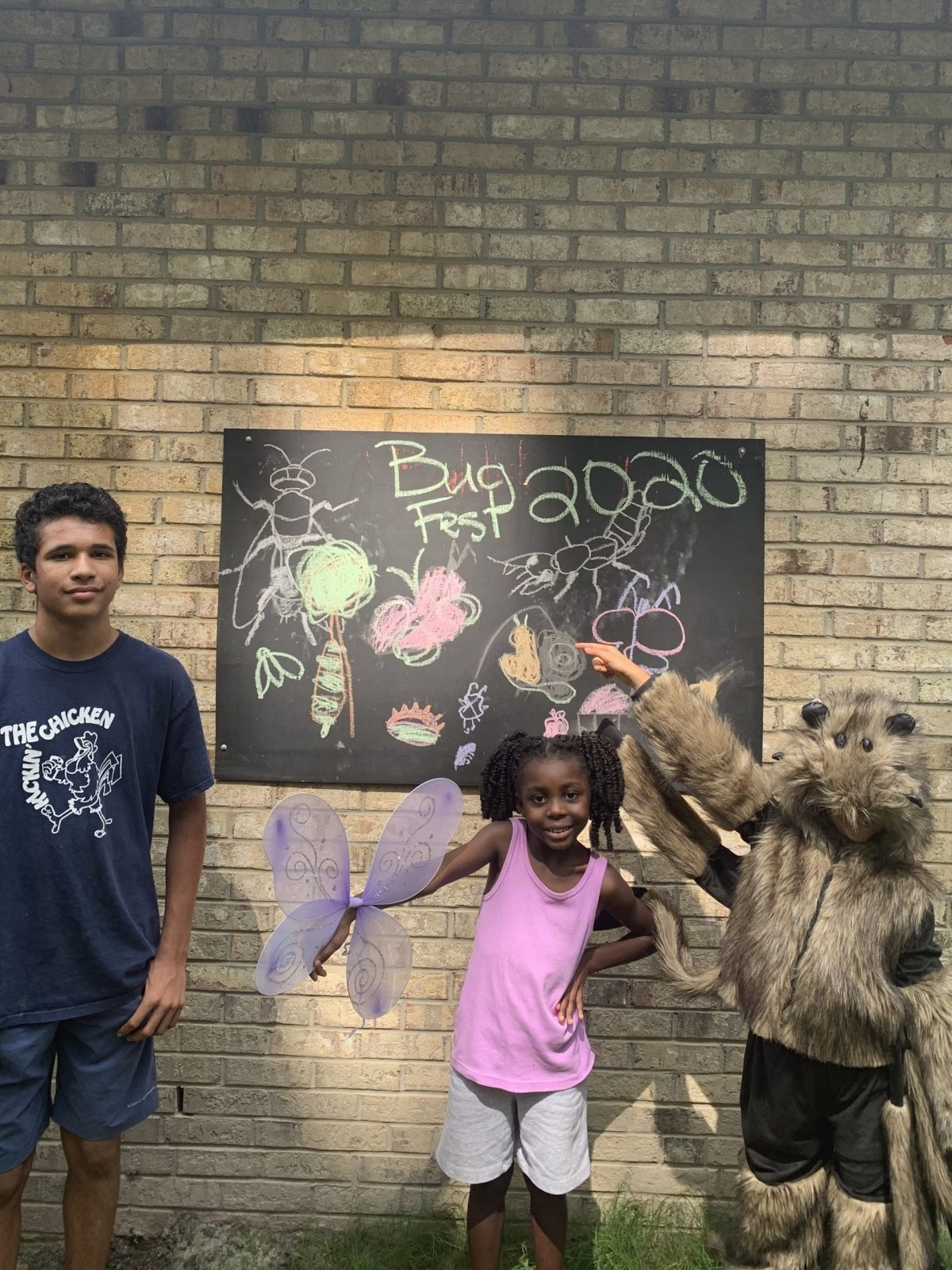 Three kids and a bugfest chalkboard-one is a hairy spider costume