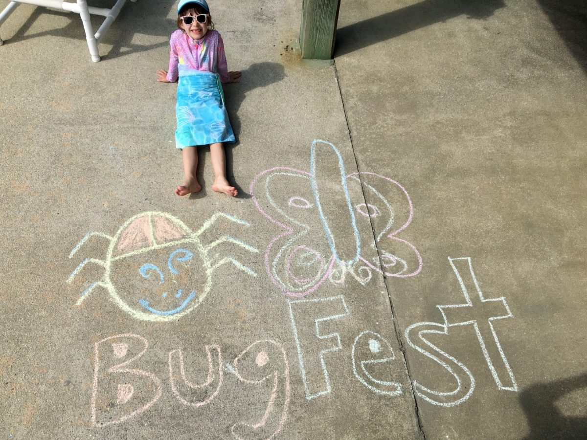 A little girl in sunglasses by bugfest in chalk