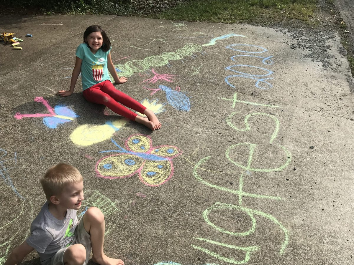 two kids with chalk art