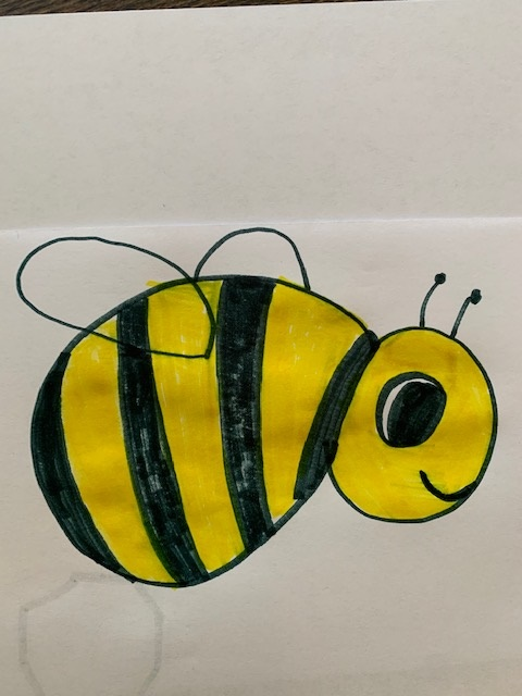 A child's drawing of a bee