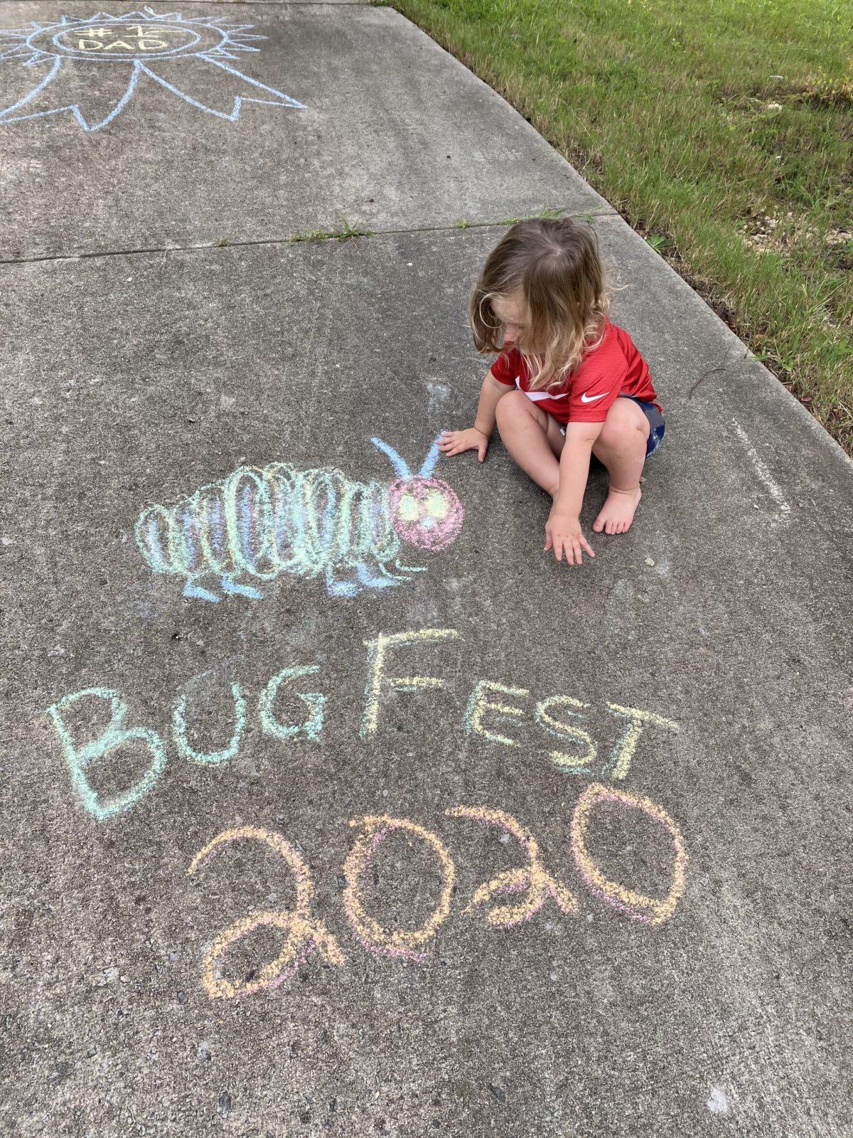 a little girl a caterpillar and chalk bugfest 2020