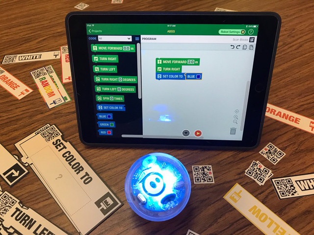 CodeSnaps running on an iPad with a Sphero robot in front.