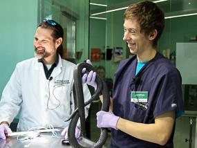Dr. Dan and Jonathan with a black milksnake.