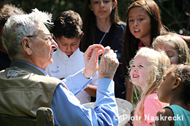 Dr. E.O. Wilson with a group of children.