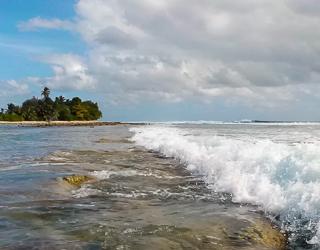 Waves meet the living bulwark on the leeward (western) side of South Keeling atoll