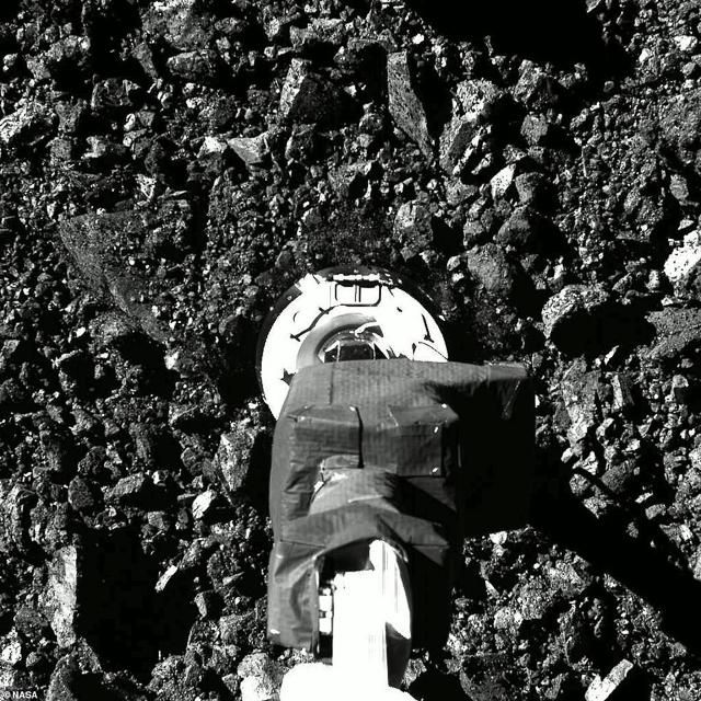 OSIRIS-Rex taking a sample of Bennu