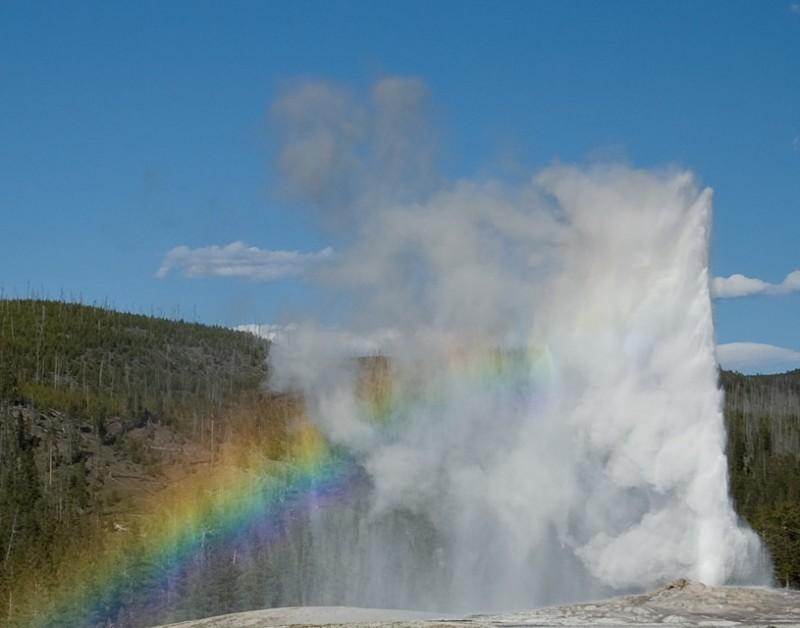 Rainbow and geyser in Yellowstone