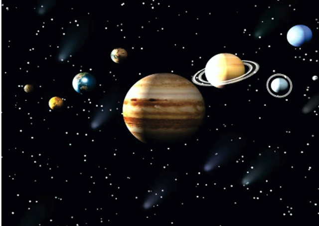 The solar system with Jupiter in the foreground.