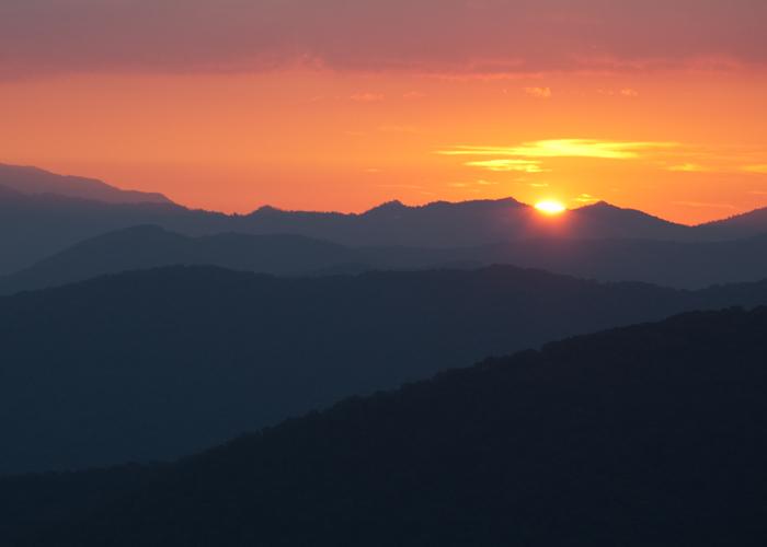 Sunset over the misty ridges of the Blue Ridge Mountains. Photo: Melissa Dowland/NCMNS