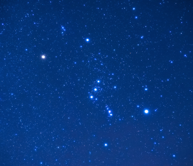 A blue sky with Orion's stars shining brightly.