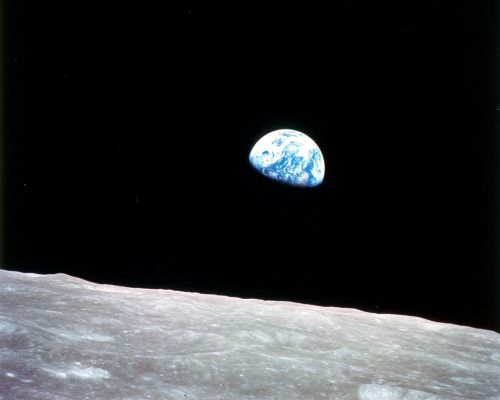 A photo of Earth rising from the vantage of the moon
