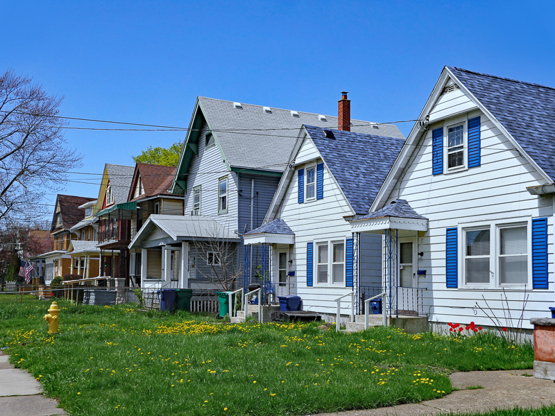 Row of lower-income houses with little tree cover.