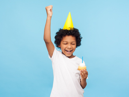 Birthday boy with cupcake
