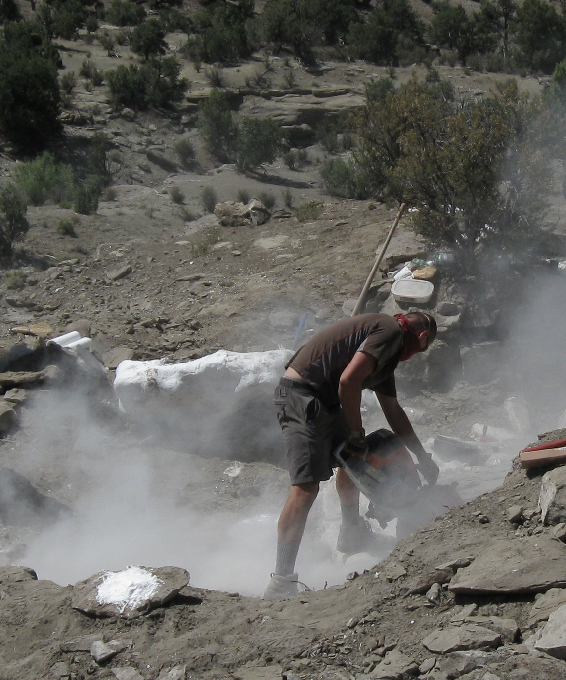 Using a rock saw to help excavate a duckbilled dinosaur skeleton from Grand Staircase Escalante National Monument, Southern Utah.