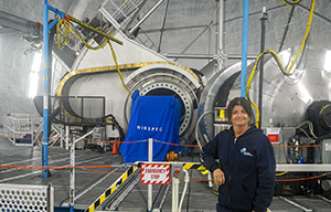 Dr. Smith on the bridge inside the Keck II dome, with NIRSPEC in the background.